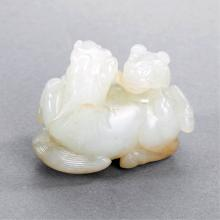 A CHINESE WHITE JADE CARVING OF TWO HORSES