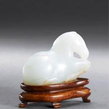 A CHINESE WHITE JADE HORSE CARVING WITH STAND