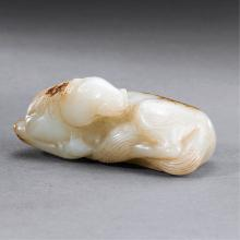 A CHINESE WHITE JADE RECUMBENT HORSE PENDANT