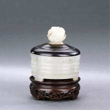 A CHINESE WHITE JADE CENSER WITH WOODEN STAND