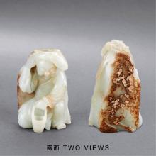 A CHINESE WHITE AND RUSSET JADE CARVING