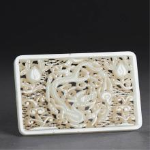 A FINELY CARVED CHINESE WHITE JADE DRAGON PLAQUE