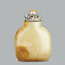 A CHINESE FINELY CARVED YELLOW JADE 'LIUHAI AND TOAD' SNUFF BOTTLE