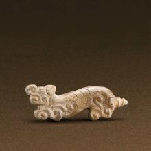 A CHINESE JADE 'TIGER' PENDANT