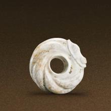 A CHINESE JADE CARVED CIRCULAR DRAGON PENDANT