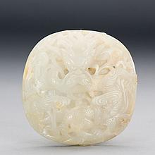 A CHINESE WHITE JADE DRAGON ORNAMENT