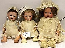 THREE GERMAN BISQUE HEAD BABY DOLLS, PAIR OF