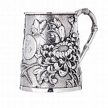 Figurative mug in Chinese silver