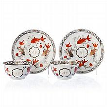 Pair of teacups with saucers 'carps' in Chinese porcelain, Qianlong