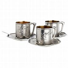 Three cups and two teaspoons in silver