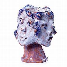 Modernist 'four faces' vase in ceramics