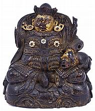 ˜A CARVED FIGURE OF JAMBHALA, TIBET OR BHUTAN, 18TH CENTURY