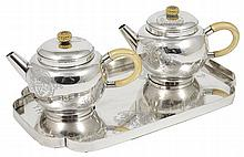 ˜A PAIR OF JAPANESE SILVER TEAPOTS AND COVERS AND A SILVER TRAY, EARLY 20TH CENTURY