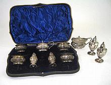 AN EDWARDIAN SILVER SEVEN-PIECE CONDIMENT SET, EDWARD BARNARD & SONS LTD, LONDON, 1902