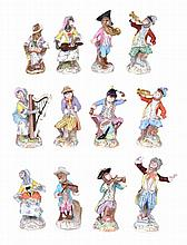 A MATCHED SET OF TWELVE MONKEY BAND FIGURES, ONE MEISSEN, NINE DRESDEN, TWO UNMARKED, LATE 19TH / 20TH CENTURY