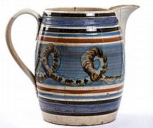 Barrel-Form Mochaware Pitcher with Earthworm Motif