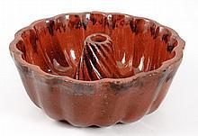 Manganese Decorated Redware Twist Center Cake Mold