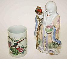 A CHINESE FAMILLE ROSE BRUSH POT, decorated with