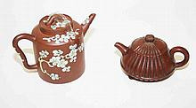A CHINESE RED STONEWARE TEAPOT AND COVER,