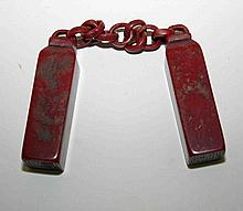 A PAIR OF CHINESE BLOOD STONE SEALS ON A CHAIN.