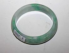 A LIGHT GREEN JADE BANGLE,  3in (8cm). (1)