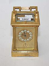 A HEAVY BRASS REPEATER CARRIAGE CLOCK, with an