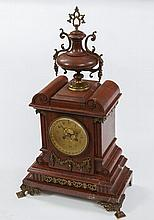 A 19TH CENTURY FRENCHY ROUGE MARBLE MANTEL CLOCK,