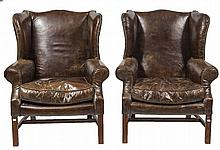 A PAIR OF GOOD QUALITY LIBRARY WING ARM CHAIRS,