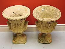 A PAIR OF COMPOSITION SANDSTONE URNS, O.R.M., of
