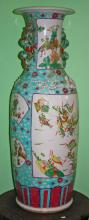 A LARGE CANTONESE PORCELAIN VASE,  profusely decorated with warriors flower