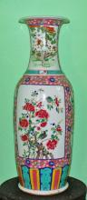 A LARGE CANTONESE PORCELAIN VASE,  the flared neck decorated with phoenix a