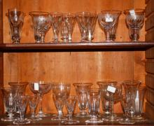 A SET OF SEVEN EARLY 19TH CENTURY CORK VASE SHAPED GLASSES,  each on stem b
