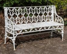 A PAIR OF HEAVY CAST IRON GARDEN BENCHES,  each  in the Gothic style, the b