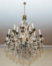 A LARGE REGENCY STYLE TWENTY FOUR BRANCH BRASS AND GLASS CHANDELIER,  the a