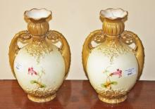 A PAIR OF FLORAL DECORATED TWO HANDLED AUSTRIAN VASES,  (one as is), 9.5''