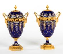 A SUPERB PAIR OF COBALT BLUE ENAMEL AND ORMOLU MOUNTED MANTLE URNS AND COVE