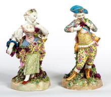 A PAIR OF 19TH CENTURY PORCELAIN SPILL VASES,  one modelled as a young boy
