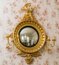 A REGENCY GILT GIRANDOLE, the ball and rope moulded frame crested with a st