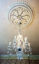 A FINE ELEVEN BRANCH CRYSTAL GLASS CHANDELIER,  the top with six scrolled c