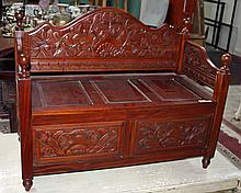 A MODERN CARVED MAHOGANY MONK'S BENCH, with lift top seat on turned legs, 3