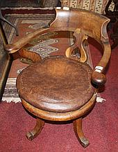 AN OAK CIRCULAR SWIVEL DESK CHAIR. (1)