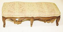 A SERPENTINE SHAPED FRENCH WALNUT STOOL, early 20th century, the rectangula