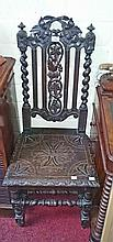A PAIR OF GOTHIC STYLE CARVED OAK HALL CHAIRS, on barley twist and turned l