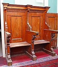A SET OF GOTHIC STYLE PITCH PINE CHURCH STALLS, 19th century, each with a d