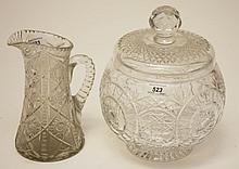 A HEAVY CUT-CRYSTAL BULBOUS BOWL AND COVER, probably Waterford, on a short