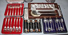 A COLLECTION OF CUTLERY CASES, one containing a set of six silver plated pa