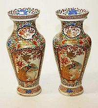 A PAIR OF JAPANESE KUTANI VASES, c. 1900, of baluster form, each with a fla