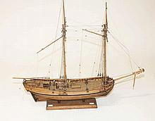 A WOODEN SCALE MODEL OF A DOUBLE MAST SCHOONER,  with riggings, wooden