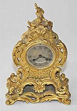 A 19TH CENTURY FRENCH ORMOLU MANTEL CLOCK,  in the Rococo style, creste