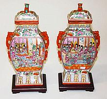 A PAIR OF CHINESE FAMILLE ROSE PORCELAIN VASES AND COVERS,  O.R.M, each